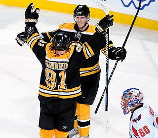 David Krejci celebrates with Marc Savard after scoring the game winner in overtime.  (Getty Images)