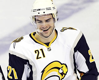 With a hat trick in a Buffalo rout, Drew Stafford has three personal reasons to smile and 10 in all. (AP)
