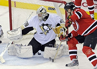 Bobby Holik puts the puck between Marc-Andre Fleury's pads for his first goal in eight games.  (AP)