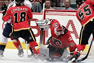 Miikka Kiprusoff's defensemen protect the crease area to make the goalie's job a lot easier. (Getty Images)