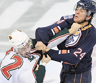Cal Clutterbuck and Steve Staios drop the gloves and pound each other before getting separated. (AP)