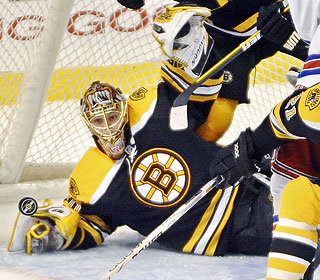 Bruins goalie Tuukka Rask keeps his eyes on the puck as he drops down to deflect this shot. (AP)
