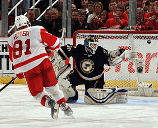 Marian Hossa caps his night by beating Chris Mason top shelf, glove side to end the shootout.  (Getty Images)
