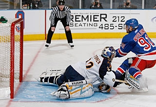 Markus Naslund converts in the SO after also scoring late, but it's still not enough. (Getty Images)