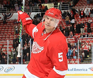 Nicklas Lidstrom scores the winning goal to celebrate his 1,300th NHL game in style. (Getty Images)