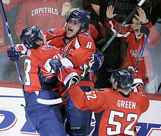 Never one to hide his emotions, Alex Ovechkin (8) jumps for joy with teammates after his goal. (AP)