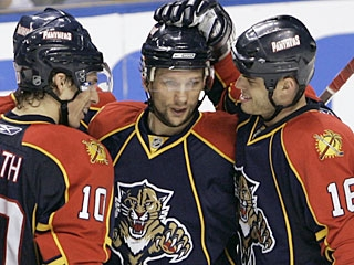 Richard Zednik (center) gets accolades from teammates after scoring a spectacular goal. (AP)