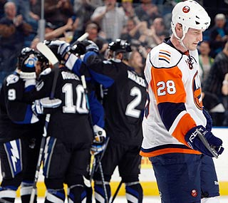 The Islanders aren't all that happy when Gary Roberts nets the game's only goal in the third.  (Getty Images)