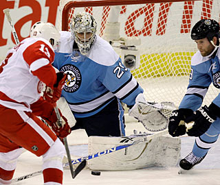 Marc-Andre Fleury has rebound problems, and Pavel Datsyuk cashes in twice.  (AP)