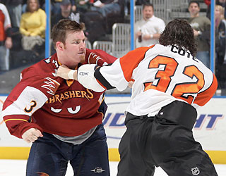 Things get heated when Atlanta's Eric Boulton and Philly's Riley Cote square off.  (Getty Images)