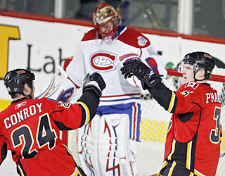 Craig Conroy and Dion Phaneuf celebrate after the latter scores to give Calgary its first lead.  (AP)
