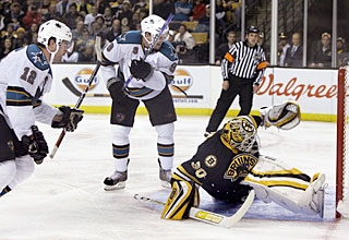 Patrick Marleau (12) scores his 27th goal and spoils Tim Thomas' 200th game in the NHL. (AP)