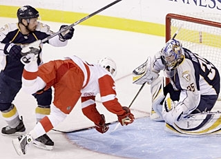 Ville Leino does not score on this chance, but he does take a dive into goalie Pekka Rinne. (AP)