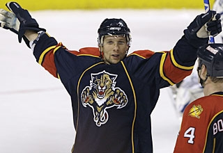 Richard Zednik scores the last two of four consecutive goals for the Panthers. (AP)
