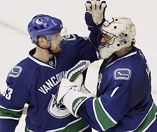 Henrik Sedin, who caps the scoring for Vancouver, also appreciates Roberto Luongo's effort. (AP)