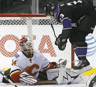Dustin Brown tries to screen Miikka Kiprusoff, but there's no fooling the goalie on this night. (AP)