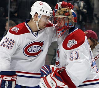 Jaroslav Halak (right) blocks 46 shots to shepherd the Canadiens to a road victory. (AP)