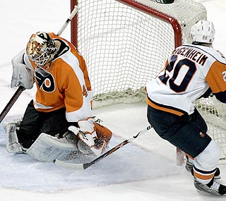 Flyers goalie Martin Biron tallies 38 saves and his 10th consecutive win over the Islanders.  (AP)