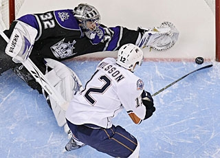 Robert Nilsson slips a backhander past Jonathan Quick for the final shootout goal. (AP)