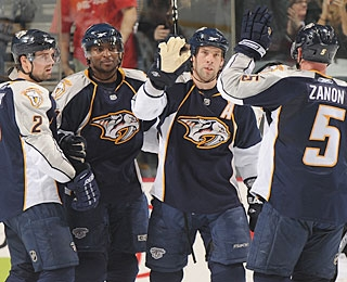 David Legwand (center) does not get credit for a hat trick, but does score three times. (Getty Images)