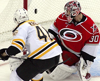 David Krejci reaches the 20-goal mark with this short-handed tally past Cam Ward. (AP)