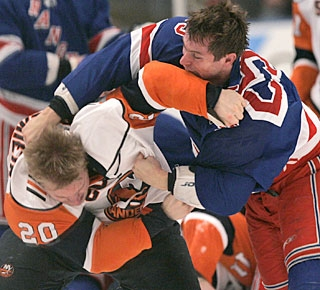 Rangers winger Petr Prucha gets the best of Islanders' Sean Bergenheim (20) in a second-period fight. (AP)