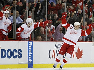 Detroit's bench cheers Nicklas Lidstrom on after the defenseman scores his power-play goal. (AP)