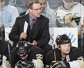 In his second game, Dan Bylsma gets his first win in charge of the Penguins bench. (Getty Images)
