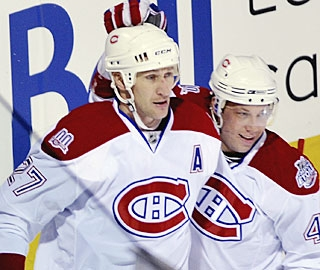 In addition to celebrating a goal, Alexei Kovalev also records two assists against Ottawa. (AP)