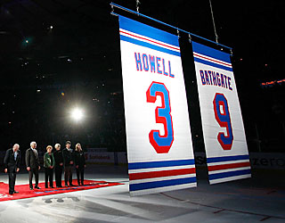 HOF Rangers Harry Howell and Andy Bathgate (bottom left) watch their numbers get retired.  (Getty Images)