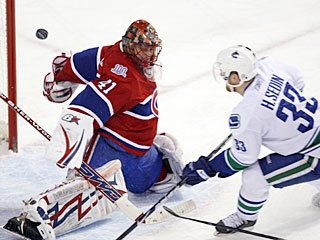 Jaroslav Halak turns away a short-handed breakaway by Henrik Sedin in the second period. (AP)
