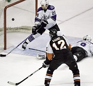 Simon Gagne adds an empty-netter for good measure with just one tick left on the clock. (AP)