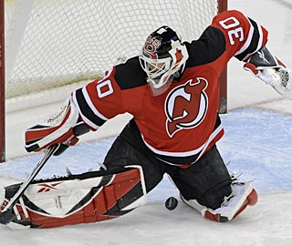 Back from elbow surgery, Marty Brodeur stops 24 shots for his 99th regular-season shutout. (AP)