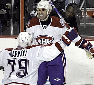Mathieu Schneider celebrates his third goal in five games since joining the Canadiens. (AP)