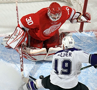 Chris Osgood keeps busy with big saves like Kyle Calder's shot from point-blank range. (Getty Images)