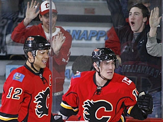 Michael Cammalleri (right) scores at least two goals in a game for the seventh time this season. (AP)