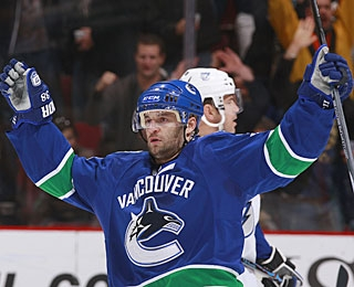 Pavol Demitra, who assists on both Vancouver goals, celebrates Steve Bernier's marker. (Getty Images)