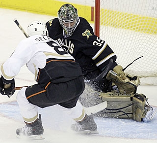 Teemu Selanne finds a way to beat Marty Turco for what proves to be the winning goal. (AP)