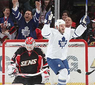 Toronto's Ian White celebrates teammate Pavel Kubina's winning goal in overtime.  (Getty Images)