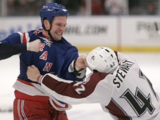 No, that's not a smile by Colton Orr, who pummels Chris Stewart as things get testy late in the game. (AP)