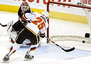 David Moss' second goal is just too easy. Later, he adds an empty-netter to complete his hat trick. (AP)