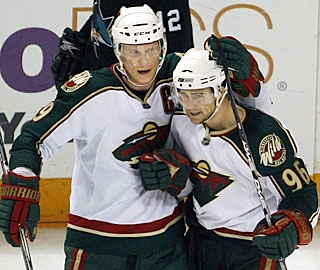 Mikko Koivu (left) snaps an eight-game goal drought with two in a game for the third time this season. (AP)