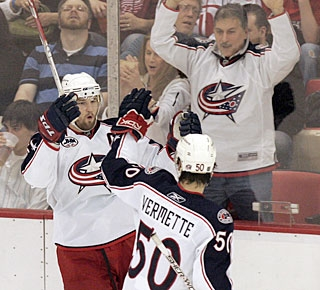 Rick Nash celebrates with new teammate Antoine Vermette and the fans also jump for joy. (AP)