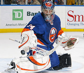 Yann Danis is solid between the pipes as he helps the Isles kill off seven power plays. (Getty Images)