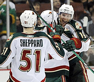 Stephane Veilleux (right) celebrates one of his two goals as the Wild end their road trip 2-4.  (AP)