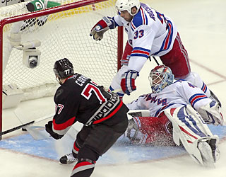 Joe Corvo gives the Hurricanes the only score they need with a goal in the opening period.  (AP)