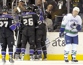 Teammates surround Jarret Stoll (second to right) after he scores the first of his two goals.  (AP)