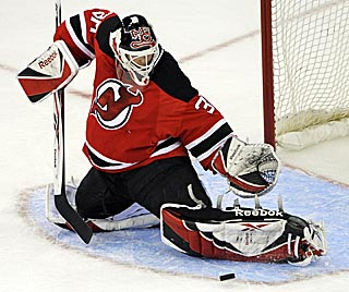 Martin Brodeur continues his stellar post-surgery play and the Devils move closer to first in the East. (AP)