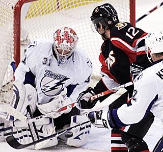 Ottawa's Mike Fisher (12) moves in to score in overtime against Lightning goalie Karri Ramo.  (AP)