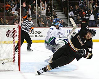 Scott Niedermayer tumbles to the ice after scoring in overtime against Roberto Luongo.  (Getty Images)